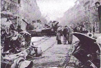 Destroyed tank and building on the streets of Budapest